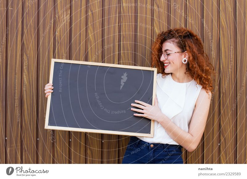 Young redhead business woman holding a blank blackboard Lifestyle Elegant Education Blackboard Student Teacher Work and employment Profession Workplace Business