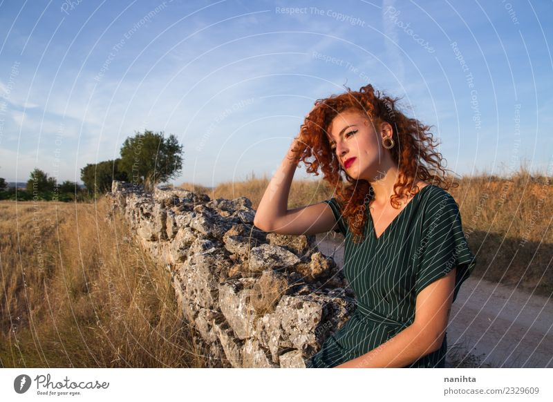Young redhead woman enjoying the sunset outdoors Lifestyle Elegant Style Beautiful Hair and hairstyles Wellness Harmonious Senses Relaxation Vacation & Travel