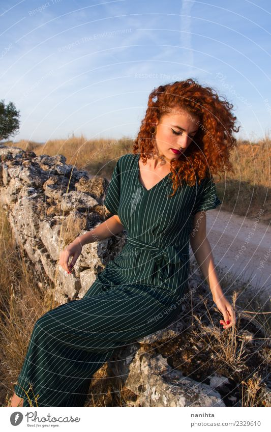 Young redhead woman enjoying the sunset outdoors Lifestyle Elegant Style Wellness Harmonious Relaxation Calm Vacation & Travel Summer Summer vacation