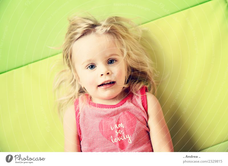 I'm having fun 2 Child Lie Toddler Girl Face 1 1 - 3 years Movement Fitness Smiling Laughter Athletic Sports Happiness Fresh Healthy Happy Beautiful Green Joy