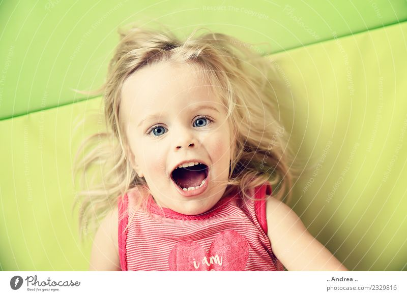 Child Human being Joy Girl Healthy Sports Movement Laughter Happy Playing Lie Fresh Smiling Happiness Joie de vivre (Vitality) Fitness
