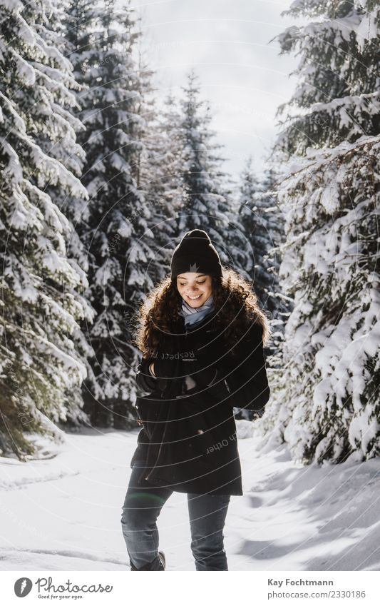 Young woman trudges through winter forest Joy Happy Wellness Life Harmonious Well-being Contentment Vacation & Travel Tourism Trip Far-off places Freedom Winter