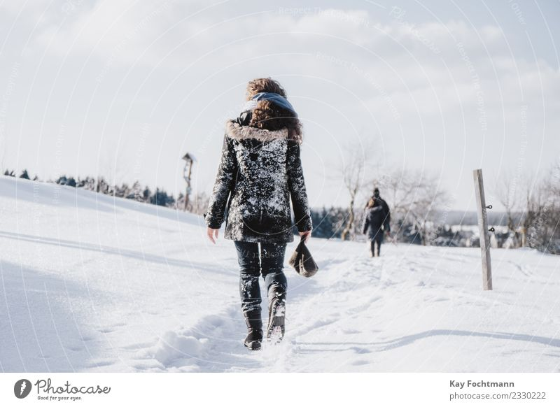 Young woman trudges through winter landscape Lifestyle Wellness Well-being Vacation & Travel Tourism Winter Snow Winter vacation Youth (Young adults) 1