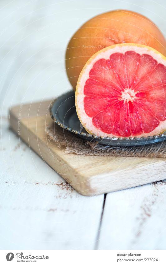 Grapefruit on old wood Food Fruit Nutrition Breakfast Lunch Dinner Picnic Organic produce Vegetarian diet Diet Juice Plate Body Healthy Healthy Eating Wellness
