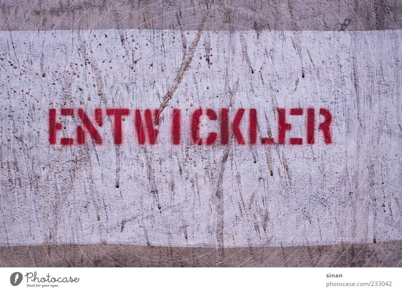 DEVELOPER Stone Concrete Characters Signs and labeling Graffiti Old Retro Gray Red Lettering developer Stencil letters Wall (building) Photography Colour photo