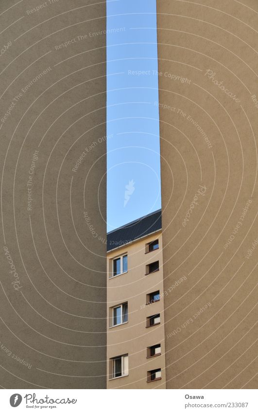 Room with a view Building Apartment Building Window Wall (building) Fire wall Facade Plaster Gray Blue Sky Slit Portrait format Copy Space right Copy Space left