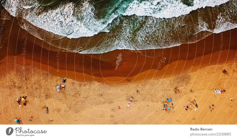Aerial View Of People Having Fun On Beach In Portugal Human being Nature Vacation & Travel Summer Blue Water Landscape Ocean Warmth Yellow Lifestyle Environment