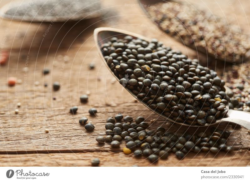 detail of puy lentils on silver spoon Vegetable Nutrition Eating Dinner Vegetarian diet Diet Spoon Table Nature Wood Metal Fitness To feed Esthetic Fresh