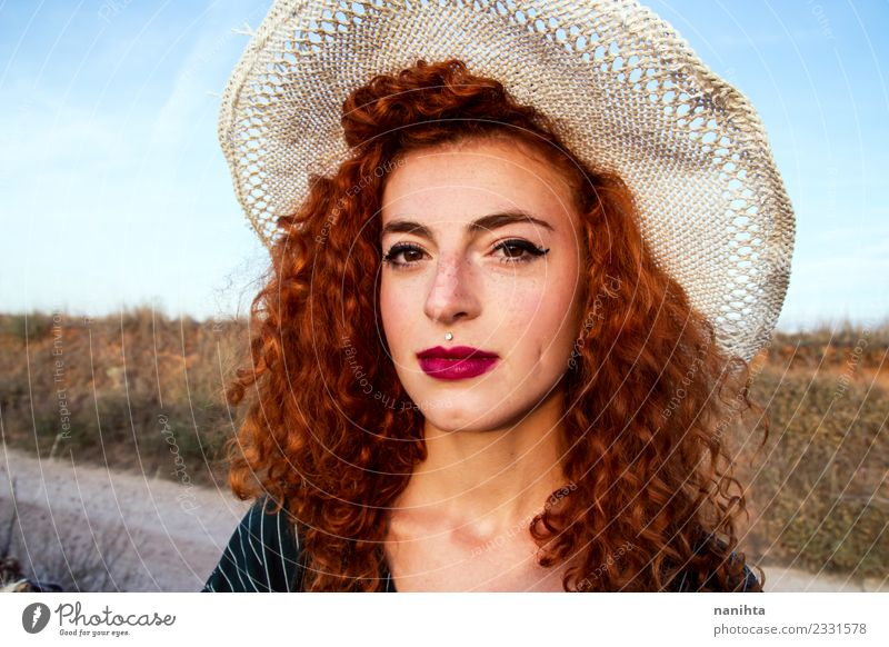 Young redhead woman wearing a wheat hat Lifestyle Elegant Beautiful Hair and hairstyles Skin Face Freckles Vacation & Travel Tourism Summer Summer vacation Sun