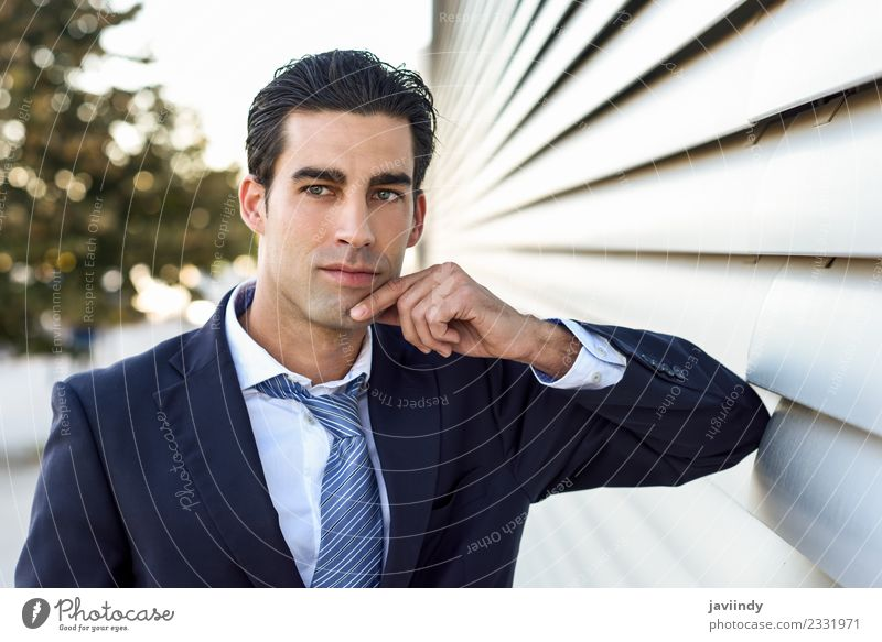 Businessman wearing blue suit and tie outdoors Success Work and employment Human being Masculine Young man Youth (Young adults) Man Adults 1 30 - 45 years