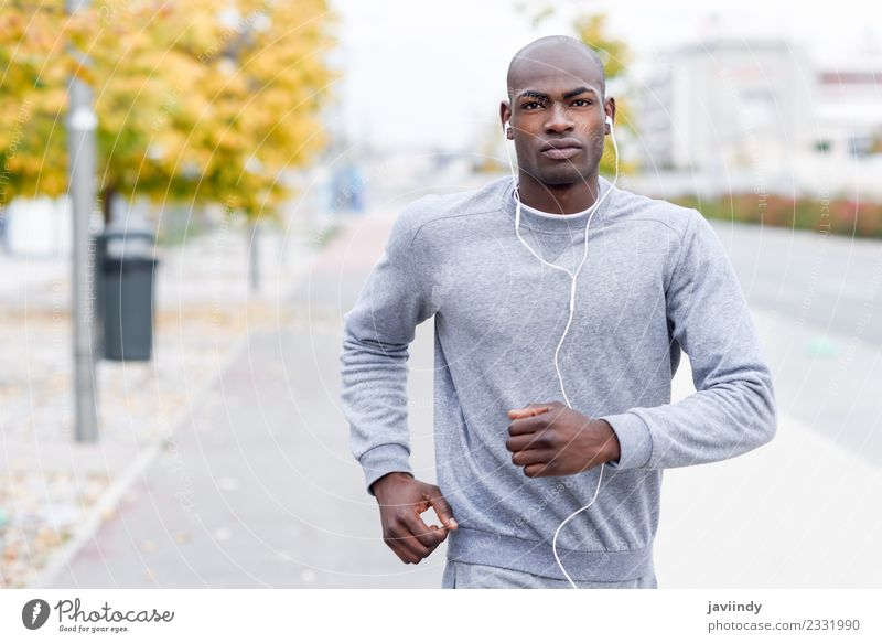 Attractive black man running in urban background. Lifestyle Body Sports Jogging Headset Human being Masculine Man Adults Youth (Young adults) 1 18 - 30 years