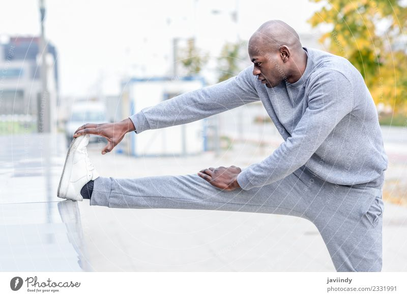 Black man doing stretching after running outdoors Lifestyle Body Sports Jogging Human being Man Adults Youth (Young adults) Legs 1 18 - 30 years Fitness