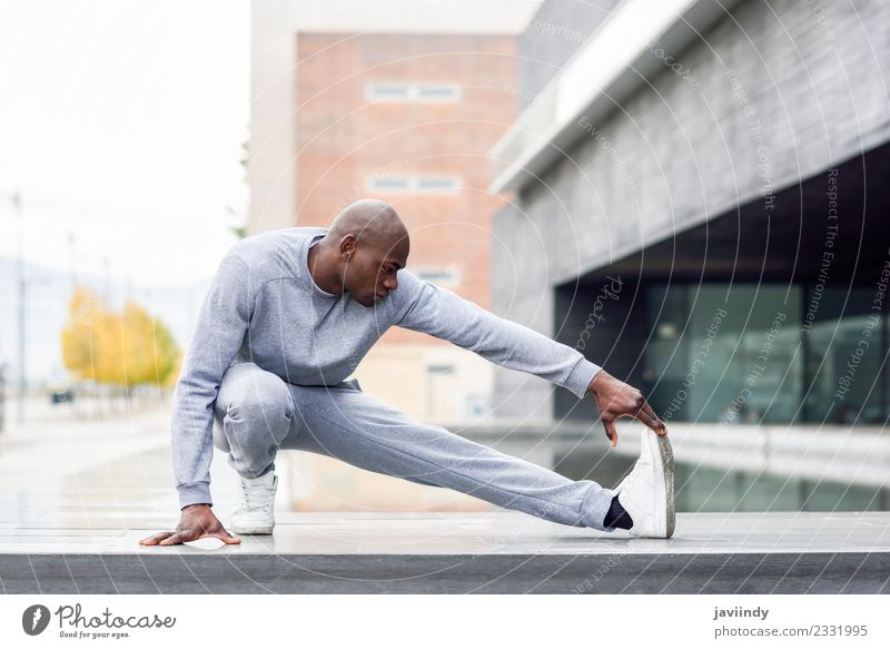 Black man doing stretching after running outdoors Lifestyle Body Sports Jogging Human being Masculine Young man Youth (Young adults) Man Adults 1 18 - 30 years