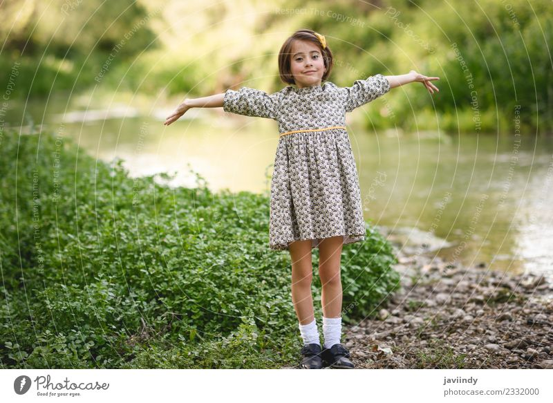 Little girl near an stream wearing beautiful dress Lifestyle Joy Happy Beautiful Playing Summer Child Human being Feminine Baby Girl Woman Adults Infancy 1