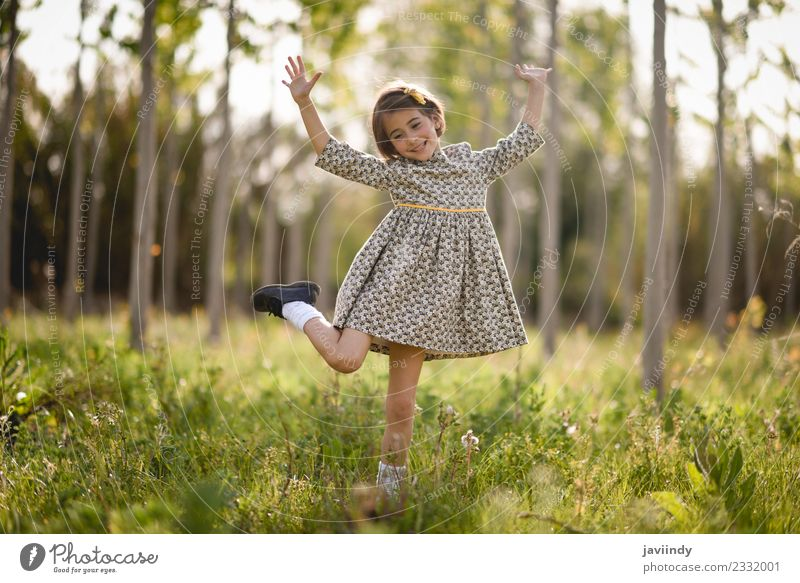 Little girl in nature field wearing beautiful dress Lifestyle Joy Happy Beautiful Playing Summer Child Human being Feminine Baby Girl Woman Adults Infancy 1
