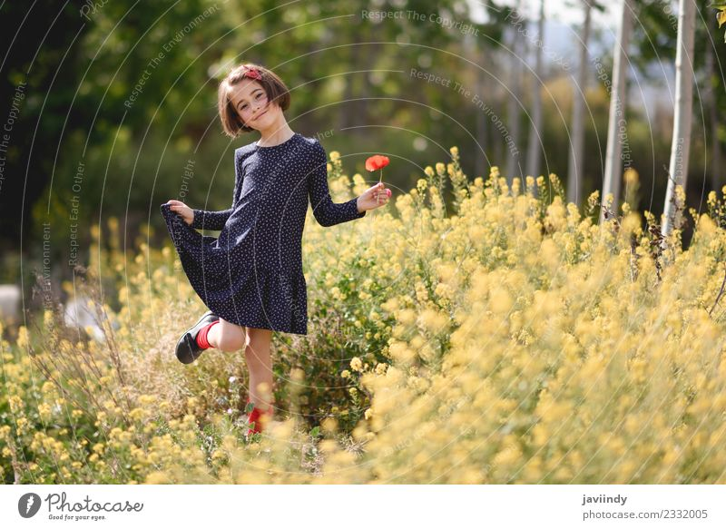 Little girl in nature field wearing dress with poppies Child Woman Human being Nature Summer Beautiful Flower Joy Girl Adults Lifestyle Meadow Feminine Grass