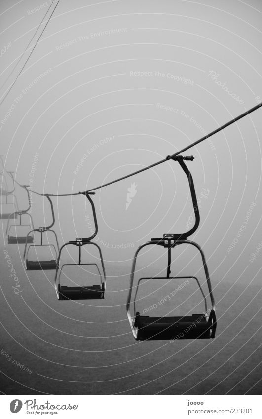 Cable car into nothing Fog Driving Gray Stagnating Central perspective Fog bank Creepy Chair lift Copy Space top Haze Bad weather Black & white photo