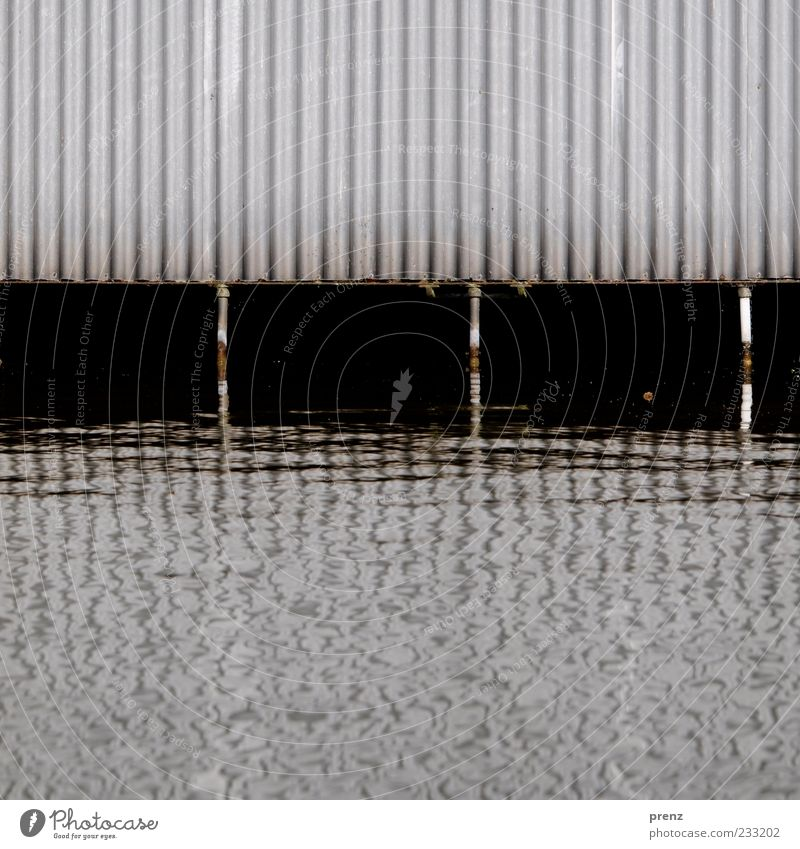 boathouse Water River bank Wall (barrier) Wall (building) Facade Metal Steel Rust Brown Gray Black White Corrugated sheet iron Support Channel Boathouse