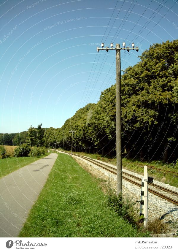 Railroad tracks Electricity pylon Avenue Cycle path Narrow-gauge railroad Bäderbahn Molli