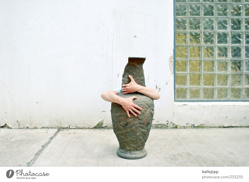 kiss me kate Human being Masculine Arm Hand Fingers 1 Embrace Vase Water jug China Porcelain Chinese Glass block Facade Colour photo Exterior shot Light Shadow