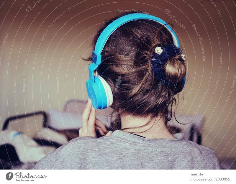 Back view of a young woman listening to music Lifestyle Style Hair and hairstyles Harmonious Senses Relaxation Leisure and hobbies Living or residing