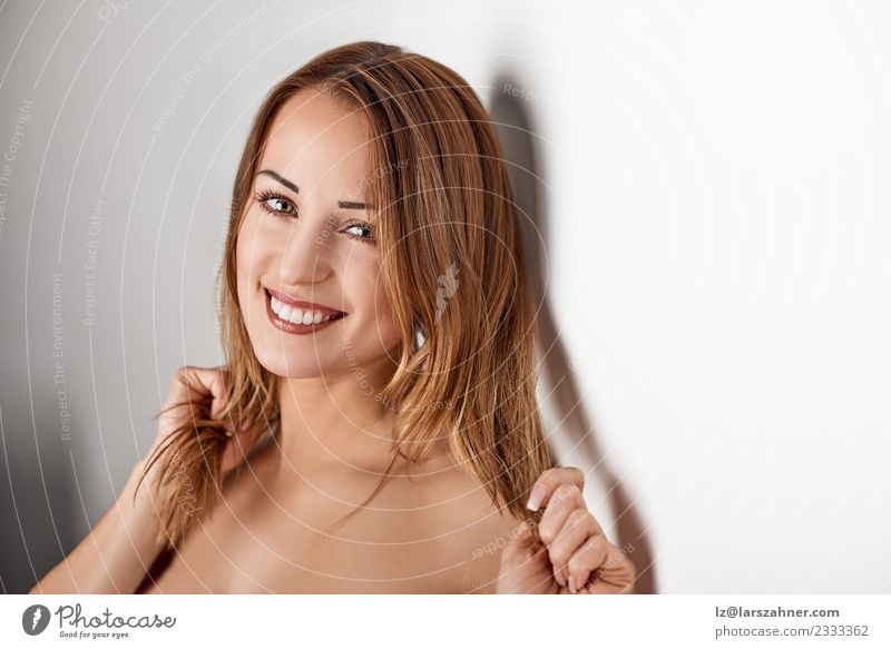 Young smiling blonde woman leaning againt wall Lifestyle Beautiful Face Medical treatment Woman Adults 18 - 30 years Youth (Young adults) Blonde Glittering