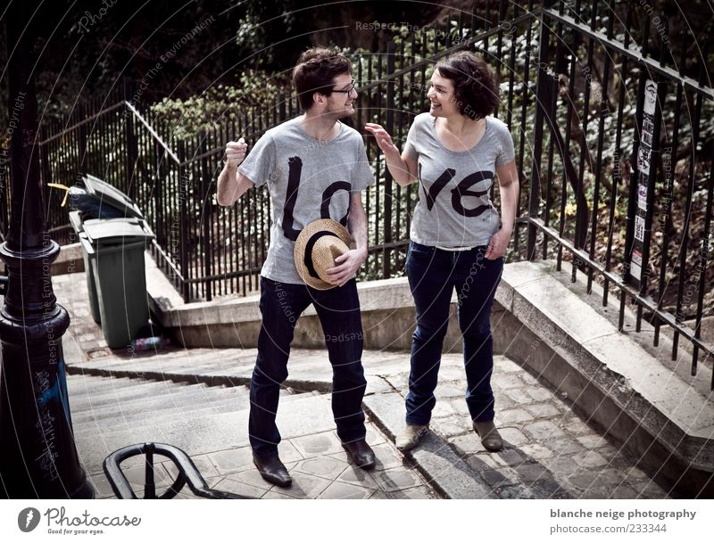 lovers Human being Masculine Woman Adults Man 18 - 30 years Youth (Young adults) paris France T-shirt Jeans Hat To enjoy Smiling Laughter Love To talk Together