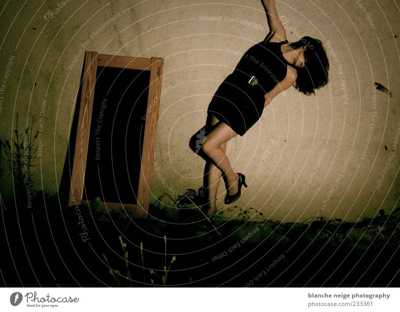 late at night.. Human being Woman Youth (Young adults) Beautiful Black Calm Adults Feminine Wall (building) Emotions Movement Garden Wall (barrier) Legs