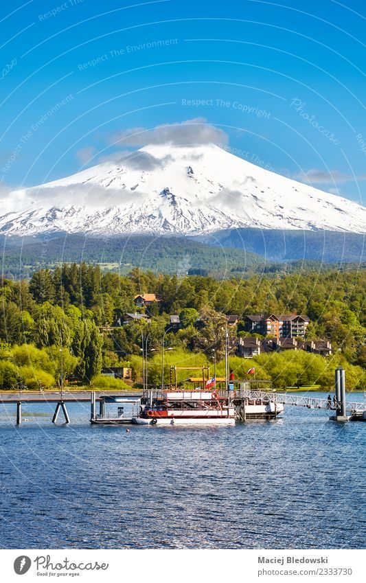 Villarrica volcano seen from Pucon, Chile. Beautiful Vacation & Travel Tourism Trip Adventure Expedition Snow Mountain Nature Landscape Sky Volcano Lake Blue