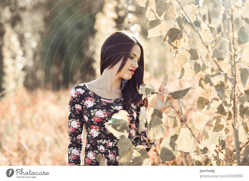 Young woman in Nature looking plants. Woman Human being Youth (Young adults) Summer Beautiful Sun Red 18 - 30 years Face Adults Lifestyle Autumn Feminine Happy