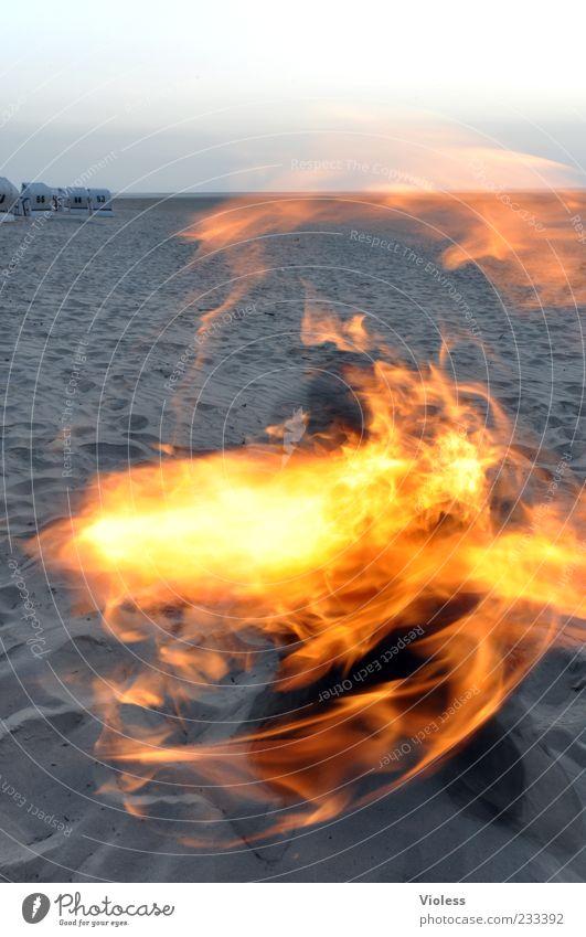Beach Far-off places Fire Kitsch Hot North Sea Flame Sandy beach Trick Torch Fiery