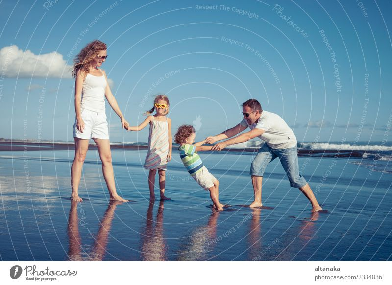 Happy family walking on the beach at the day time. Child Woman Nature Vacation & Travel Man Summer Sun Ocean Joy Beach Adults Life Lifestyle Love