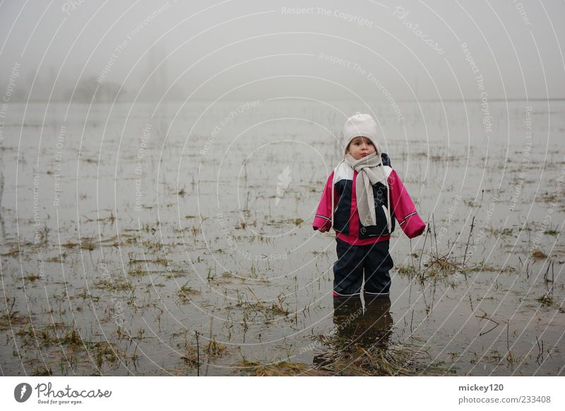 Human being Child Nature Water Autumn Cold Gray Grass Moody Infancy Field Dirty Fog Wet Climate Adventure