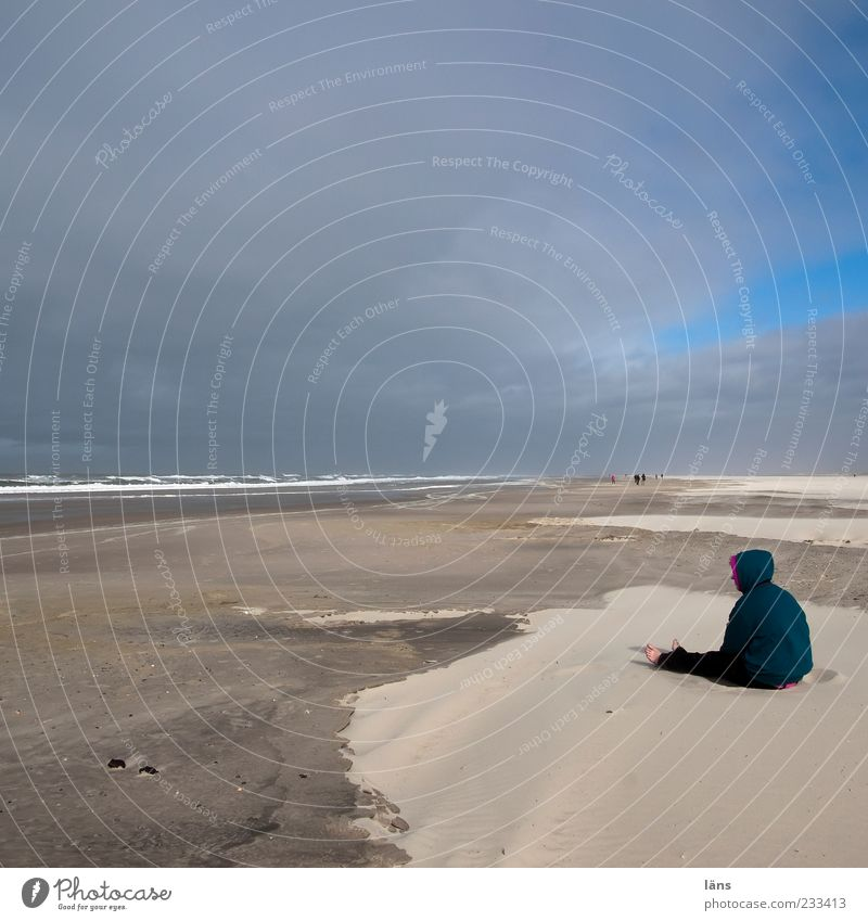 Spiekeroog, I need more sand. Human being Environment Nature Landscape Sand Clouds Sit Beach Horizon Colour photo Exterior shot Copy Space top Copy Space middle