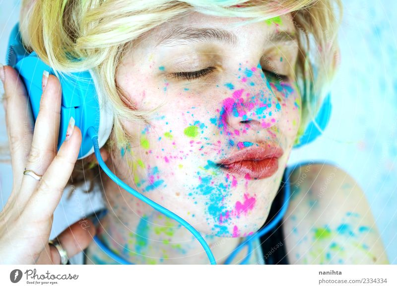 Young woman, with her face painted, is listening to music Lifestyle Style Design Exotic Joy Make-up Leisure and hobbies Human being Feminine