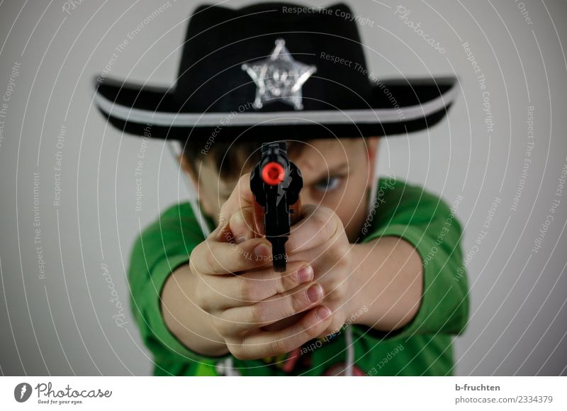 Child Dark Boy (child) Infancy To hold on Carnival Hat Force Costume Aggression Carnival costume Police Officer Schoolchild Shoot Cowboy 3 - 8 years