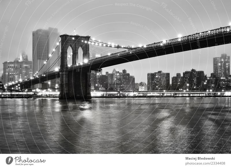 Brooklyn Bridge and the Manhattan on a foggy night. Fog River Small Town Downtown Skyline High-rise Building Architecture Tourist Attraction Landmark Black