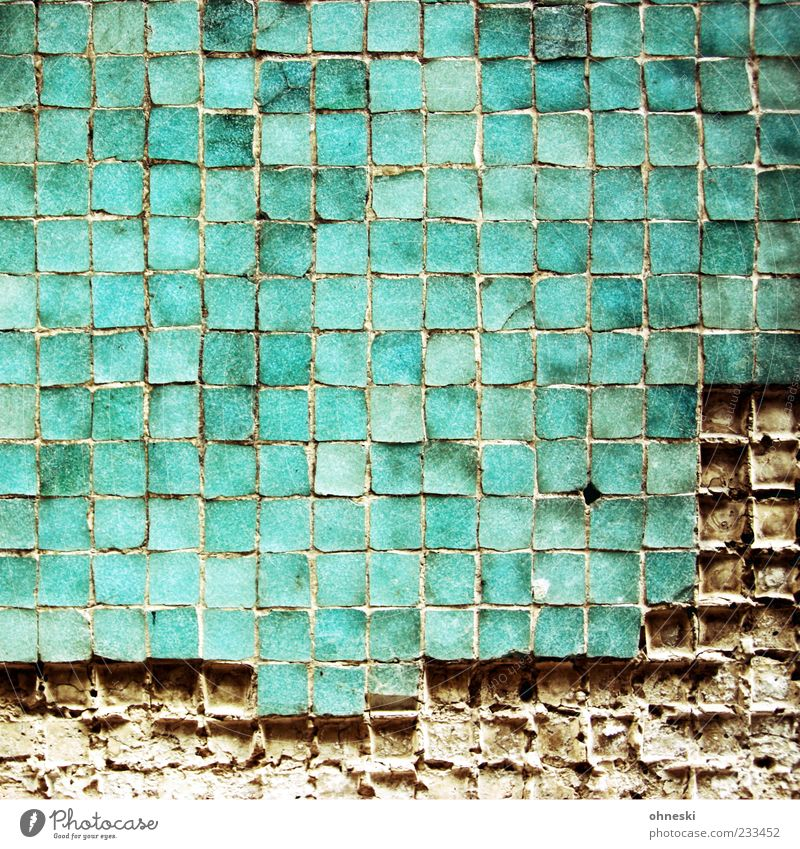 erosion Manmade structures Architecture Wall (barrier) Wall (building) Facade Tile Mosaic Broken Green Turquoise Seam Colour photo Exterior shot Abstract