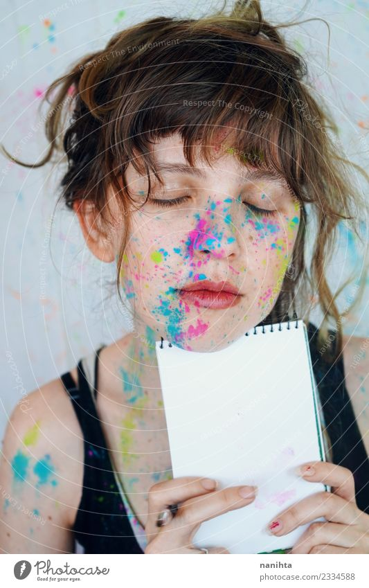 Young artist woman with paint in her face is holding a notebook Style Design Beautiful Make-up Student Apprentice Human being Feminine Young woman