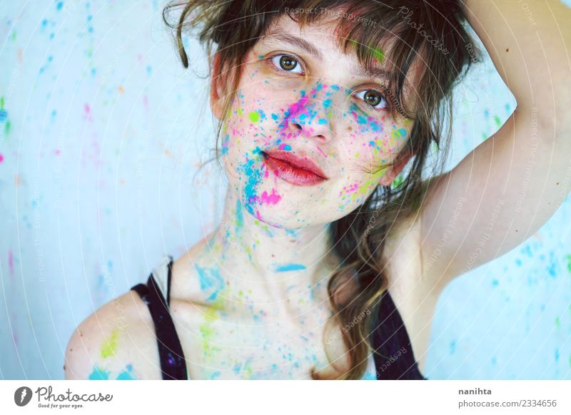Young beautiful woman with paint in her face Human being Youth (Young adults) Young woman Beautiful 18 - 30 years Face Adults Feminine Style Art Design Modern