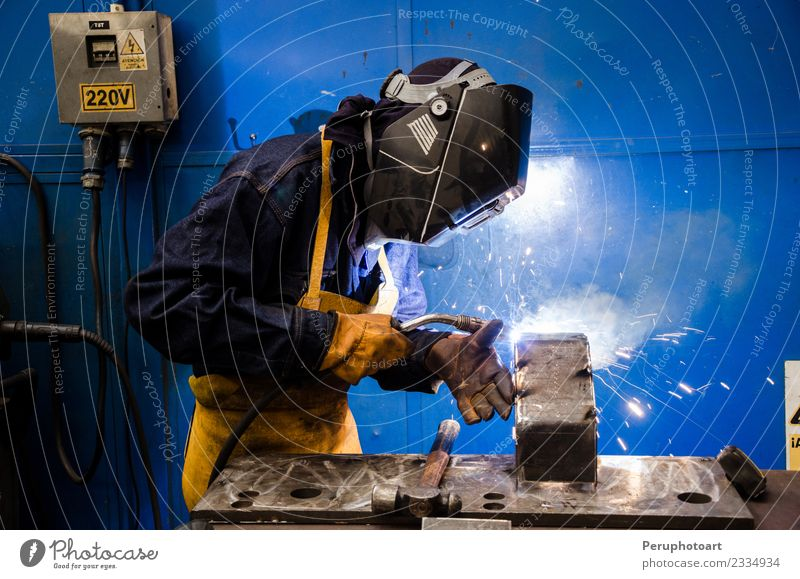 Welder Work and employment Profession Workplace Factory Industry Tool Man Adults Metal Steel Build Safety Protection construction craftsman fabricate fire flash