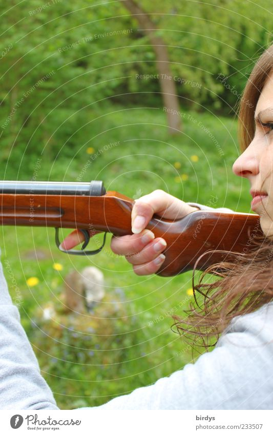 Attractive young woman with a rifle at the ready aims at her target and has her finger on the trigger Hunting Young woman Youth (Young adults) Face 1