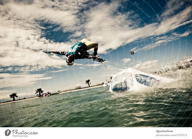tantrum Joy Sports Aquatics Sportsperson Human being Masculine Young man Youth (Young adults) 1 Water Sky Clouds Flying Jump Movement Colour photo Exterior shot