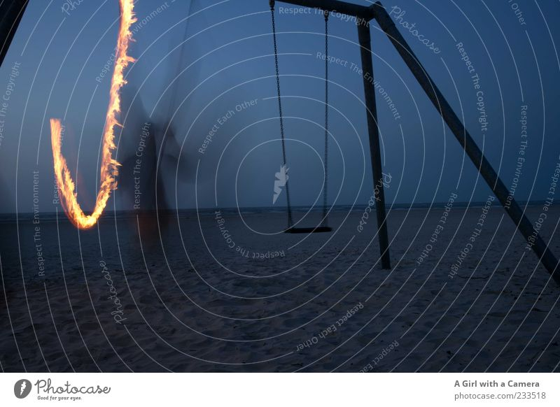Spiekeroog I One of the Swinging Paddys Beach Ocean Man Adults 1 Human being Movement To swing Blue Fire Flame Torch Long exposure Structures and shapes