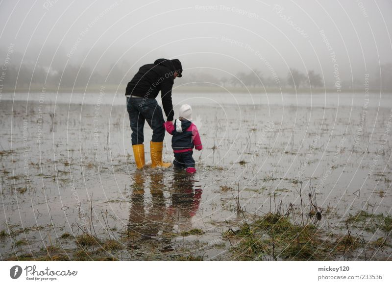 high water Adventure Human being Masculine Child Toddler Girl Man Adults 2 1 - 3 years Nature Landscape Water Climate change Bad weather Fog Grass Meadow Field