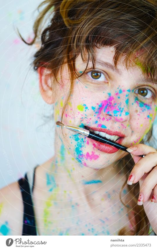 Young woman with paint in her face and a brush Style Exotic Beautiful Skin Face Make-up Harmonious Leisure and hobbies Human being Feminine Youth (Young adults)