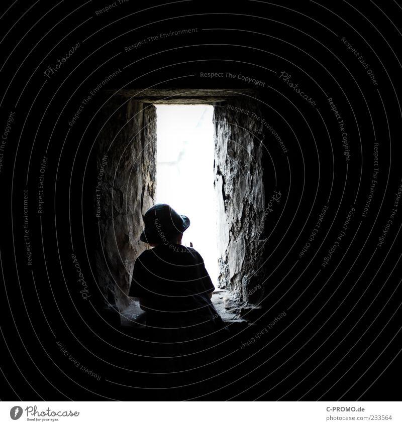 Human being Child Black Dark Window Wall (building) Boy (child) Wall (barrier) Infancy Masculine Stand Curiosity Vantage point Hat Castle Monument
