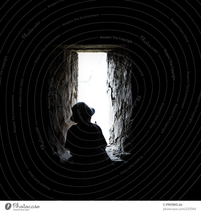 ray of hope Human being Masculine Boy (child) 1 3 - 8 years Child Infancy Castle Ruin Wall (barrier) Wall (building) Window Monument Stand Dark Black Curiosity