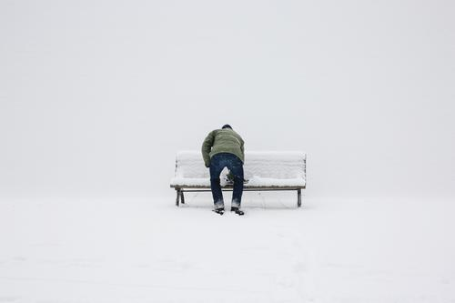 winter Human being Masculine 1 45 - 60 years Adults Downtown Berlin Town Capital city Bench Winter Snow Colour photo Exterior shot Copy Space left