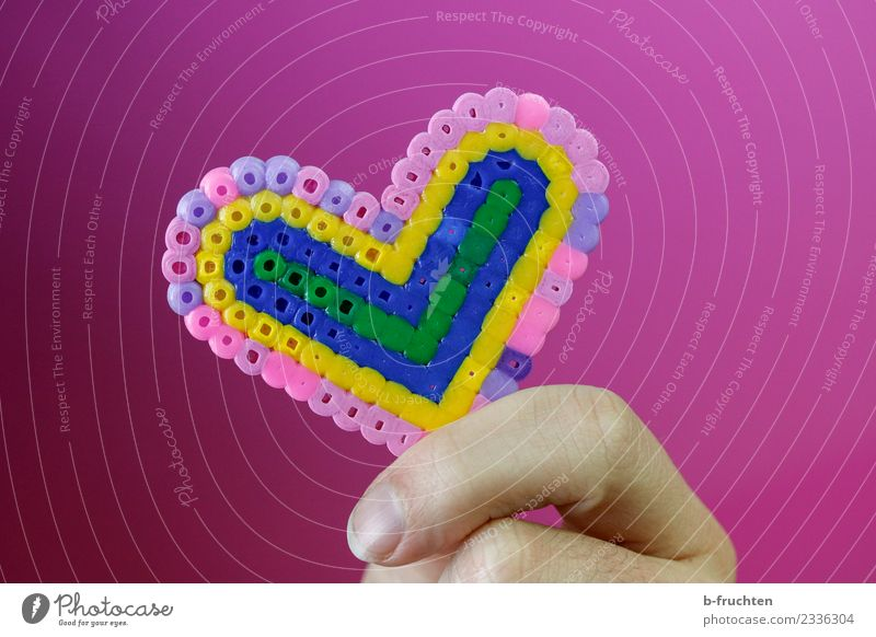 Heart made of beads Fingers Plastic To hold on Pink Friendship Love Infatuation Romance Desire Heart-shaped Handicraft Colour photo Studio shot Artificial light